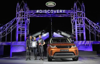 SOLIHULL, ENGLAND - SEPTEMBER 27:  (L-R) Bear Grylls, Zara Phillips and Sir Ben Ainslie pose with a certificate to recognise the official Guinness World Record for the Number of Lego pieces uses in a single structure during the launch of Land Rover's 'New Discovery' at Packington Hall on September 27, 2016 in Solihull, England. Land Rover revealed their brand new Discovery with the help of ambassadors Zara Phillips, Bear Grylls and Sir Ben Ainslie against the backdrop of the replica of London's Tower Bridge, made entirely from Lego. The structure broke the Guinness World Record for the greatest number of Lego bricks used in a sculpture with over 5.8 million pieces.  (Photo by Dan Kitwood/Getty Images for Land Rover) *** Local Caption *** Bear Grylls